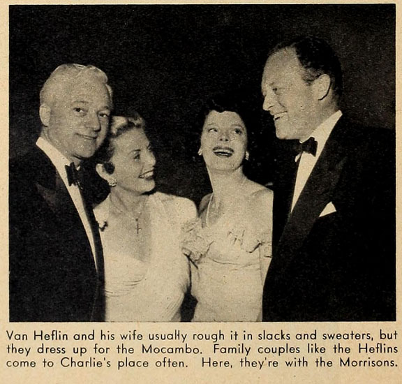 Van Heflin and his wife usually rough it in slacks and sweaters, but they dress up for the Mocambo. Family couples like the Heflins come to Charlie's place often. Here they're with the Morrisons.