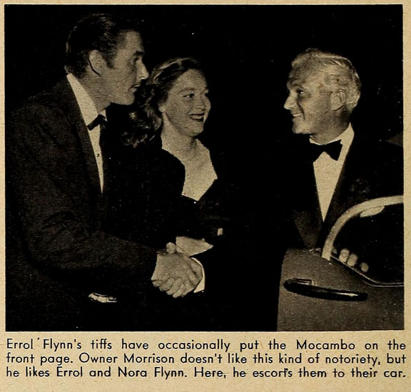 Errol Flynn's tiffs have occasionally put the Mocambo on the front page. Owner Morrison doesn't like this kind of notoriety, but he likes Errol and Nora Flynn. Here, he escorts them to their car.